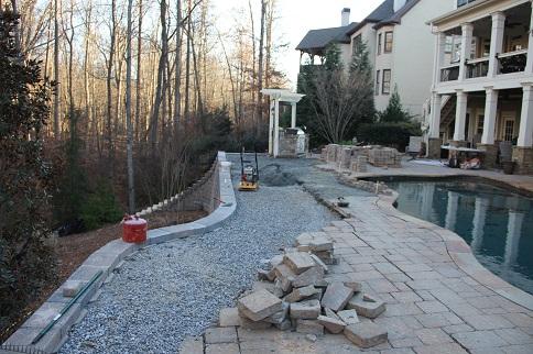 Pool deck repair - stone pavers