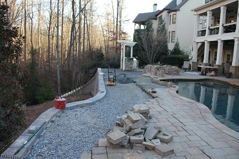 Pool deck repair - stone pavers